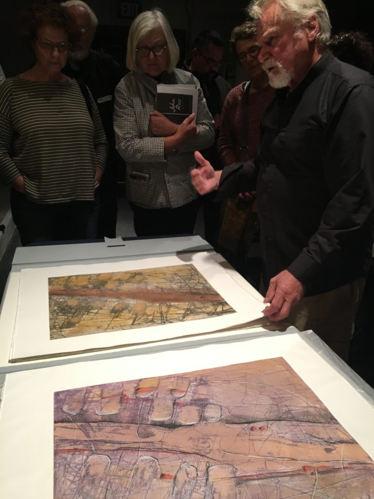 Honorary Member Dan Welden showing prints at the 2018 Annual Meeting.